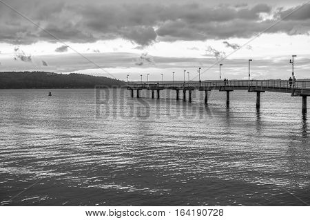 A view of the pier in Des Mointes Washington. Black and white image.