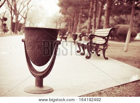 Photo in retro style - trash can in the park