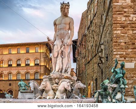 Statue of Neptune. Piazza della Signoria. Sunset, dramatic sky. Florence, Italy.