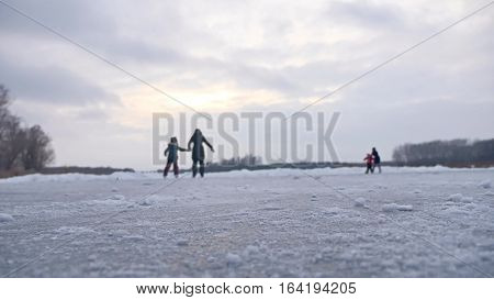 People skate on skating rink in sports the winter on ice, active winter holiday a family