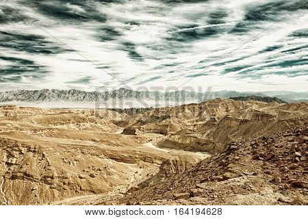 The Eilat mountains in the Negev Desert landscape Israel (HDR image with black gold filter)
