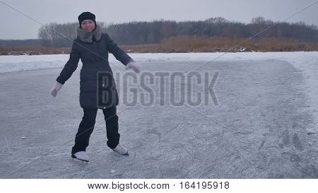 People sports skate on skating rink in the winter on ice, active winter holiday family