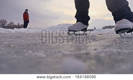 People skate on the skating rink in winter on ice, active winter sports holiday