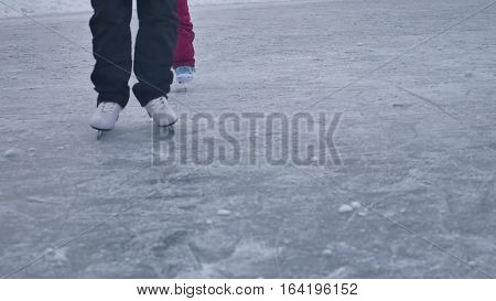 People skate on the skating rink in sports the winter on ice, active winter holiday family