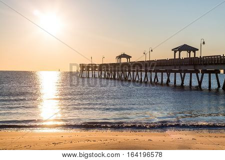 Dawn's early light on the fishing pier at Buckroe Beach in Hampton, Virginia.