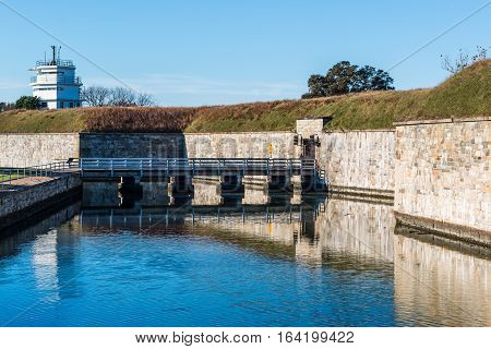 Fortress walls of Fort Monroe with bridge and moat in Hampton, Virginia.
