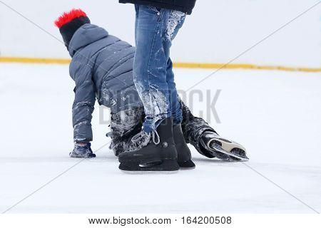 teenagers skate on the ice rink skating