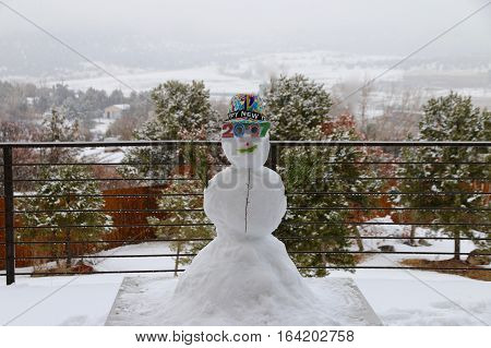 Celebrating new year 2017 with snowman in Durango, CO