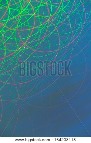 Abstract moving light patterns swilring light streams from long exosure against blue and green hue background