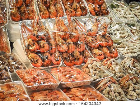 Grilled seafood (Prawn, Octopus, shrimp,Crab meat, Crayfish) Sales in the seafood market. Bangkok, Thailand
