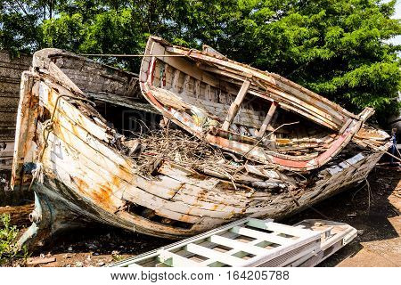 Old And Broken Wooden Boat Stranded