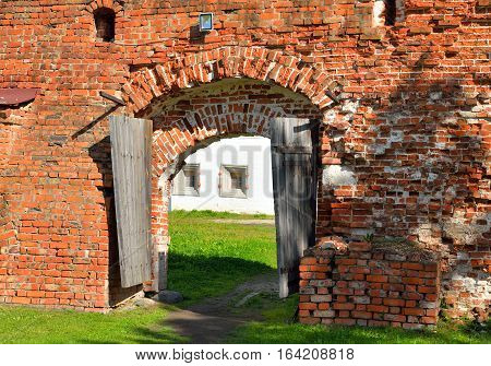 Fortress wall with gate of Kirillo-Belozersky monastery by day near City Kirillov Vologda region Russia.