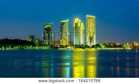 dawn at Putrajaya Lakeside with modern building long exposure.