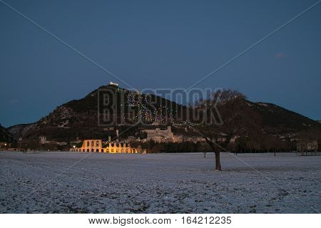 Magic Gubbio with christmas tree and snow in winter