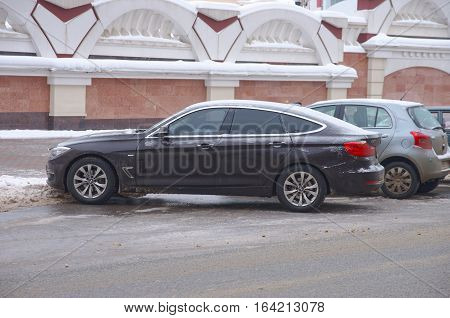 SARANSK, RUSSIA - JANUARY 6, 2017: BMW 5 Series Gran Turismo parked on city street. Photo taken at cloudy day.