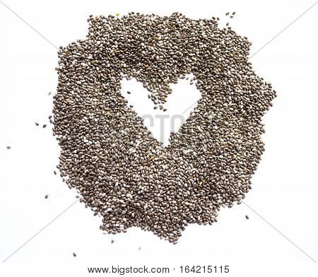 Organic dry chia seeds isolated on a white background. Nutritious chia seeds background. Top view on chia seeds.