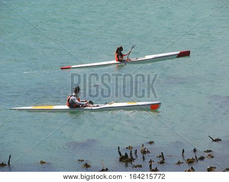 Two Canoeists Paddling In The Sea 12abd