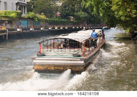 BANGKOK, THAILAND - DECEMBER 06, 2016: Fast speed express boat on Khlong Saen Seap river in downtown Bangkok