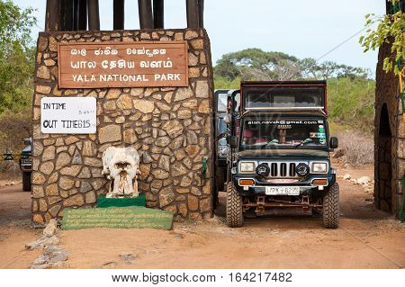 YALA, SRI LANKA. July 29, 2016: Entrance of Yala National Park in Sri Lanka. Entry of the famous nature park in Sri Lanka. A jeep is coming out of the park.