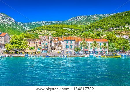 Waterfront view at mediterranean scenic town Bol, Island Brac, Croatia summertime.