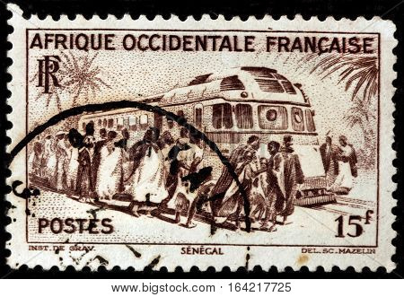 LUGA RUSSIA - NOVEMBER 29 2016: A stamp printed by FRENCH WEST AFRICA shows Rail Car and Passengers at Dakar railroad stantion circa 1947