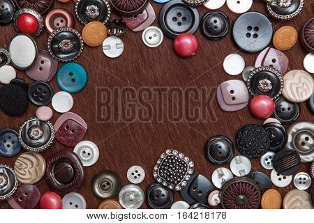 brown background with old fashion assorted buttons