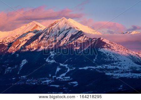 Winter sunset on the Petite and Grande Autane mountain peaks. Saint Leger les Melezes Champsaur Hautes Alpes Southern French Alps France