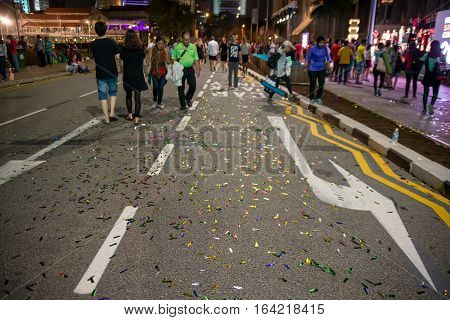 January 1 2017. Ticker tape litters the streets in front of Singapore's City Hall after celebrations welcoming the New Year.