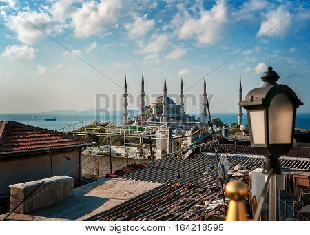 Turkey Istanbul. View over the rooftops of the old city Blue mosque (or Sultanahmet mosque) and the Bosphorus.