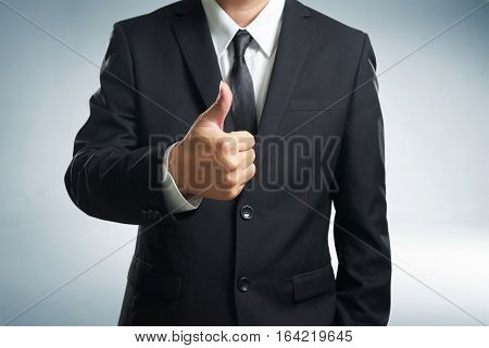 Successful businessman gives thumb up style. Likes and positive feel. Gesture good and agree finger agreement