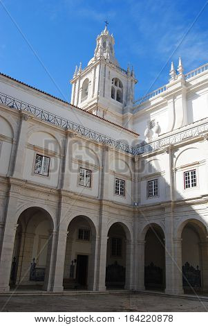 Lisbon, Portugal - October 19, 2014. Courtyard of Igreja de Sao Vicente de Fora church in Lisbon, with tower, columns and archways.