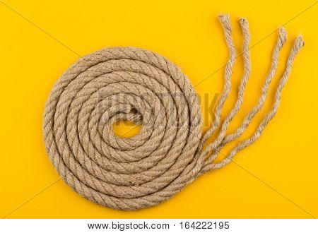 top view of rope with unraveled end on yellow background