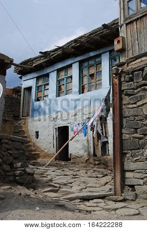 Xinaliq, Azerbaijan - August 23, 2014. Stone residential house in Xinaliq village, with linen put out to dry.