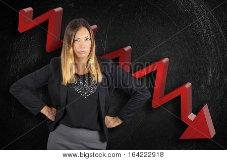 Regression business boss woman angry on chart in loss. A chief business woman is angry because his company is losing money. She has her fists on her hips and looks menacing. Black background painted scratched