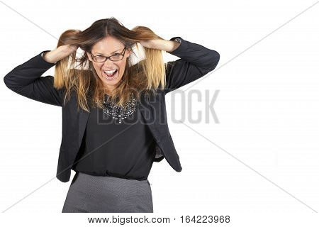 Work crisis. Woman pulling hair on white background. A beautiful business woman pulling her hair. She is stressed by the workload. With black-rimmed glasses.