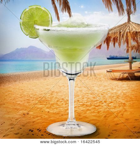 Margaritas with lime background of beach