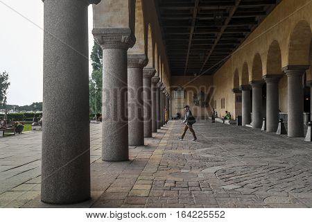 STOCKHOLM, SWEDEN - JUNE 27, 2016: This is Venetian-style colonnade that divides the City Hall from the terrace with a public garden at Lake Malaren.