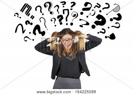 Stressed business woman question marks above head. Pulling hair. A young businesswoman is completely stressed because full of questions and doubts. Numerous small question marks above her head.