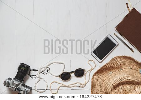 Travel Set Of Modern Girl: Female Accessories On The White Planked Surface