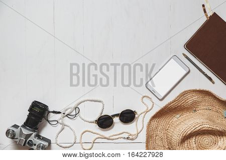 Travel Set Of Modern Girl: Female Accessories On The White Planked Surface.