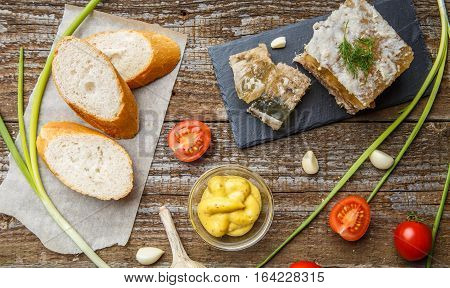 Homemade jelly meat with mustard, bread, tomatoes and garlic on the table. Holodets, traditional Russian food