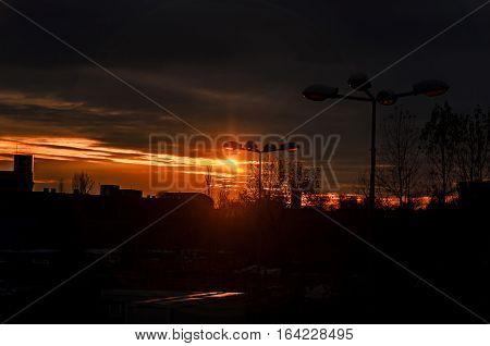 Orange Sunset, Lighting Pole, City Blocks Silhouette