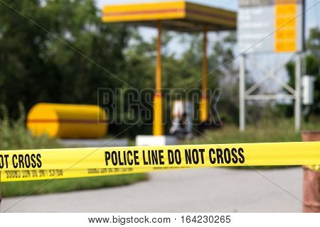 police line do no cross with gas station background in crime scene investigation training with copy space