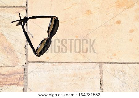 Stylish Sunglasses Isolated On A Tile Pool Deck