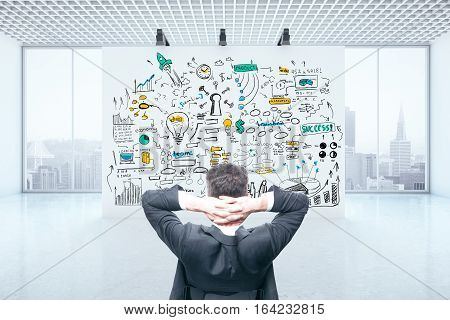 Stressed businessman in concrete room with city view and business sketch. Failure concept