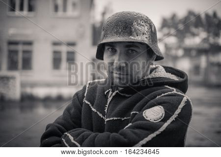 the man's portrait in a military helmet of times of World War II, in the street
