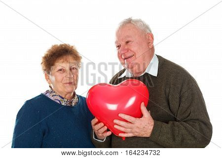 Picture of an elderly couple celebrating valentine's day - isolated background