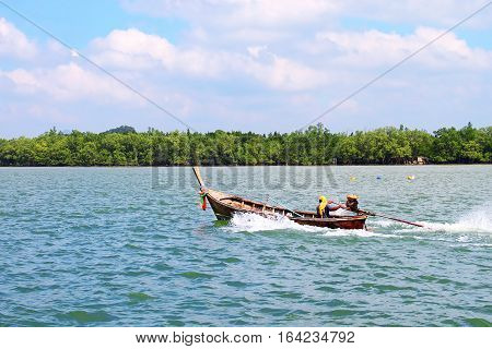 PATTAYA THAILAND - DECEMBER 09, 2013: Fisherman in a boat  in Pattay,a Thailand