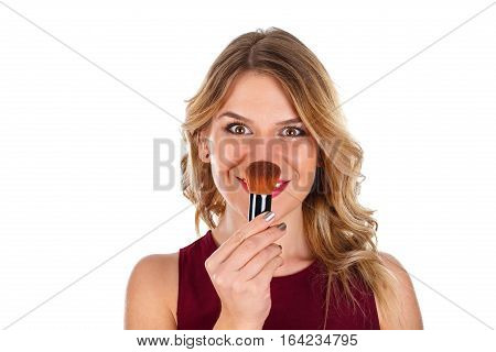 Picture of a beautiful lady powdering her nose