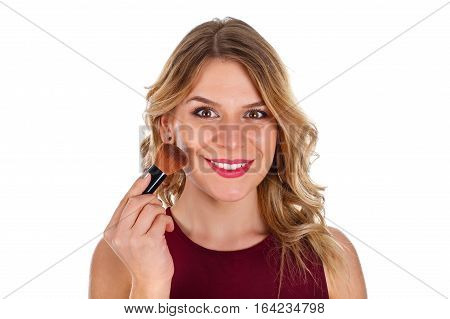 Picture of a beautiful lady powdering her face